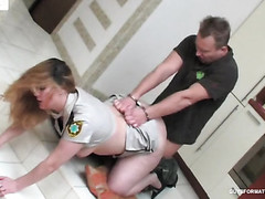 Uniformed aged officer having her way with a chained male criminal