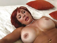 Her years of experience in fucking have a lot to say. Check out this gorgeous redhead milf and how lustfully she sucks and fucks cock. Damn the bitch knows how to swallow a cock and when she goes on top and rides this guy we can clearly see her pussy lips spreading. Yeah this milf needs some jizz deep inside her